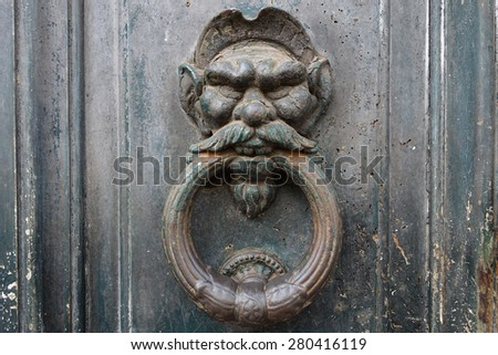 old bronze anthropomorphic door knocker