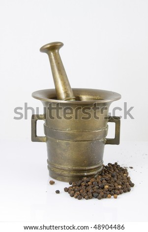 old bronze mortar and pepper - stock photo