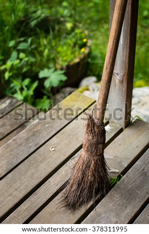 Old broom on the patio - stock photo