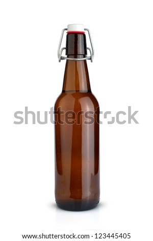Old brown bottle of beer isolated on white. - stock photo