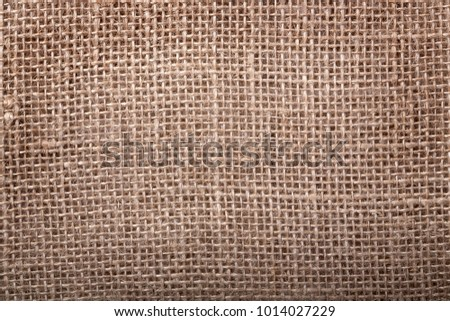 Old brown burlap texture background