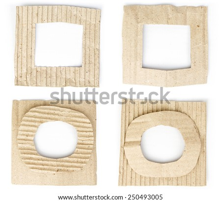 Old brown cardboard frame set isolated on white - stock photo
