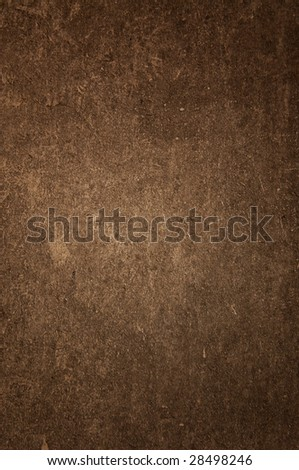 Old brown cement plaster as a background.