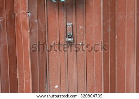old brown iron door - stock photo