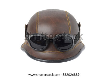 old brown leather helmet with goggles on white background - stock photo