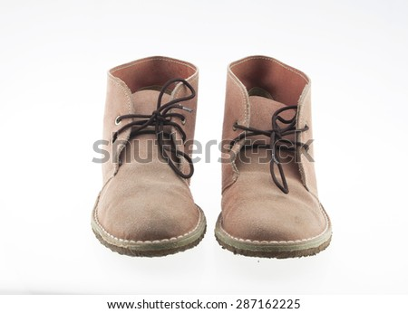 Old brown leather shoes isolated on white background. - stock photo