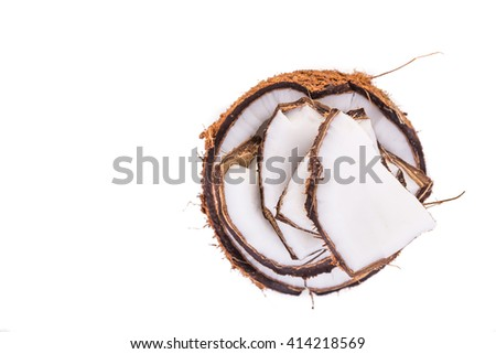Old brown organic coconut fruit copra broken into pieces and stacked on white background - stock photo