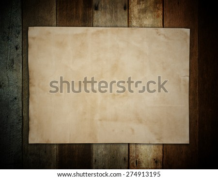 old brown paper on wooden wall background for texture - stock photo