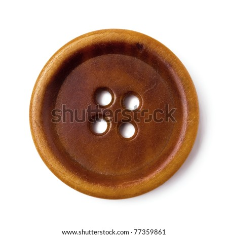 Old brown sewing buttons isolated on white - stock photo