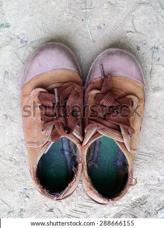 Old brown sneakers , Students sneakers - stock photo