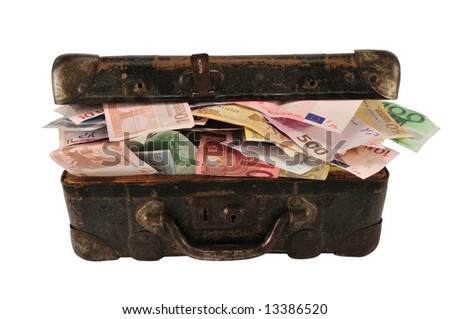 Old brown suitcase with full of different money, isolated on white. - stock photo