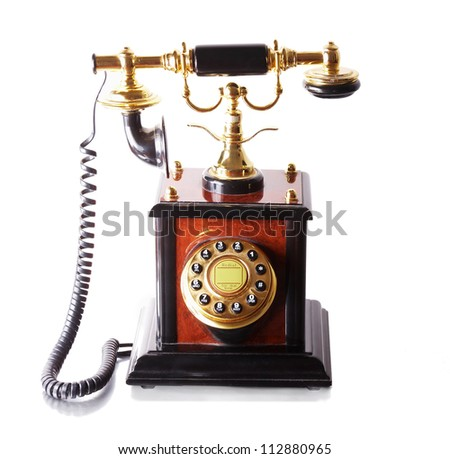 Old brown telephone over white background - stock photo
