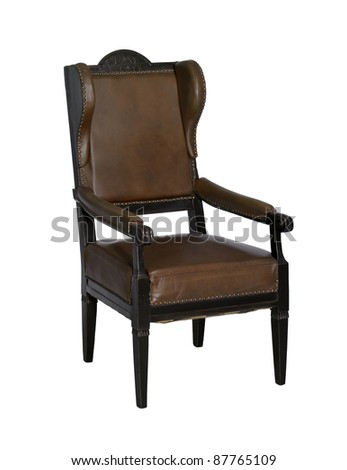 old brown winged chair isolated on white with clipping path - stock photo