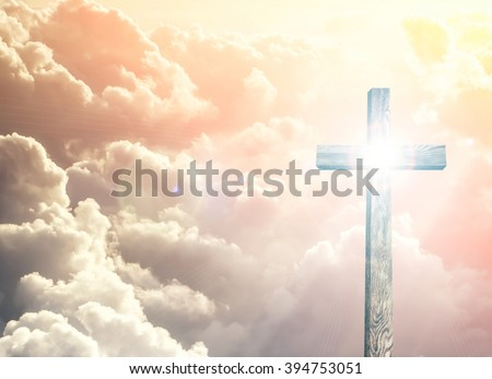 Old brown wooden cross, with sun flash  - stock photo