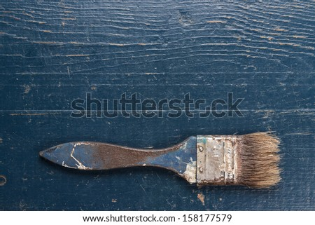 old brush on the blue wooden table - stock photo