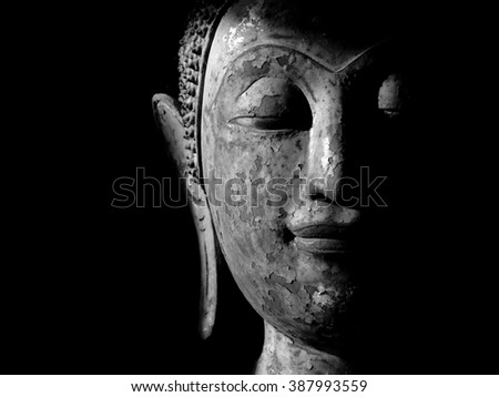 old Buddha face black and white - stock photo
