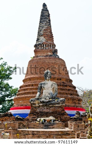 Old buddha statue and pagoda with white sky, Thailand. - stock photo