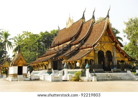 Old Buddhist Temple of Wat Xieng Thong in Luang Prabang, Laos, Southeast Asia - stock photo