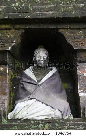 Old Budha Statue Smiling - stock photo