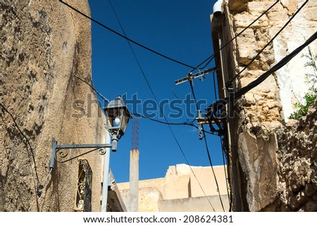 Old Buidling in Narrow Street - stock photo