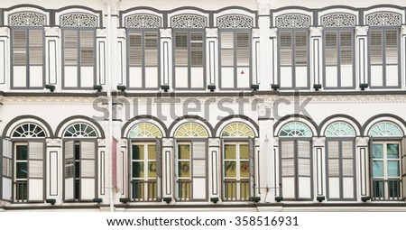 Old building, Beautiful white facade with lots of windows  - stock photo