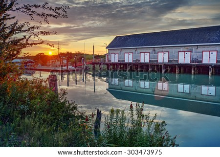 Old building by the river - stock photo