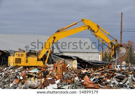Old Building Demolition for a New Road and Bridge - stock photo