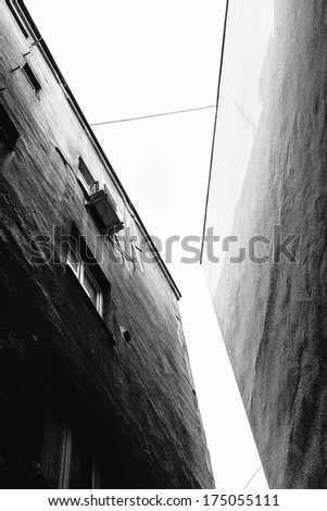 Old building exterior, black and white - stock photo