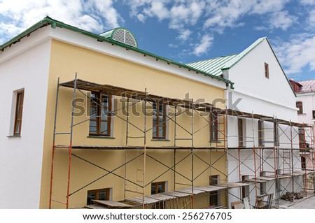 Old building facade with scaffolding under reconstruction
