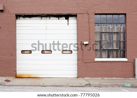 old building garage - stock photo