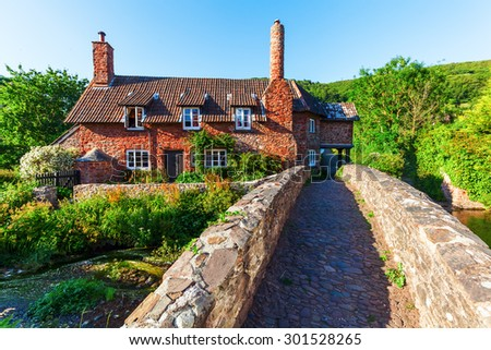 old building in Allerford, Somerset, England. Allerford is famous for its much photographed packhorse bridge and picturesque cottages - stock photo