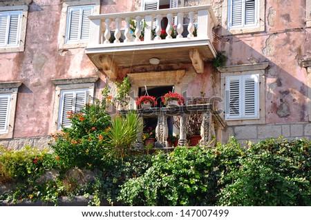 old building in korcula island with balkony - stock photo