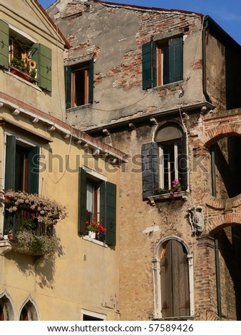 old building in venice showing window boxes, and archways