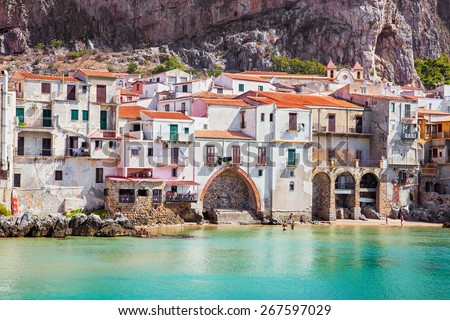 Old building on beach in Cefalu , Sicily, Italy. - stock photo