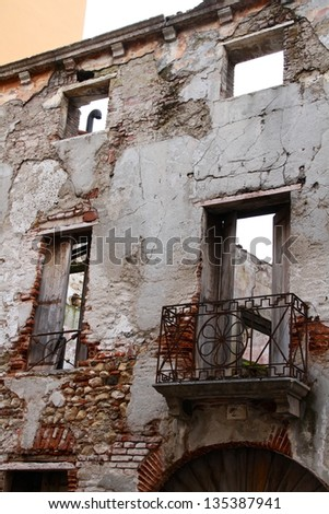 Old building ruined facade - stock photo
