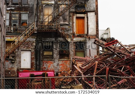 Old building still standing at work site - stock photo