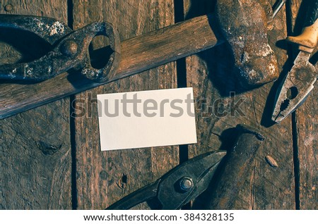 Old building tools  on a wooden desk, mockup, close up - stock photo