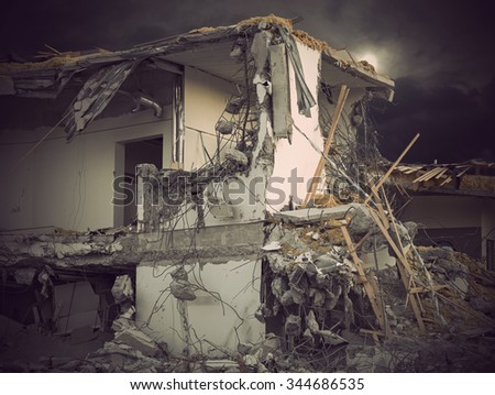 Old building under demolition, lots of debris - stock photo