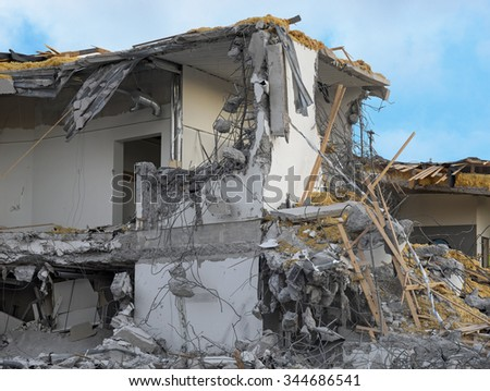 Old building under demolition, lots of debris - stock photo