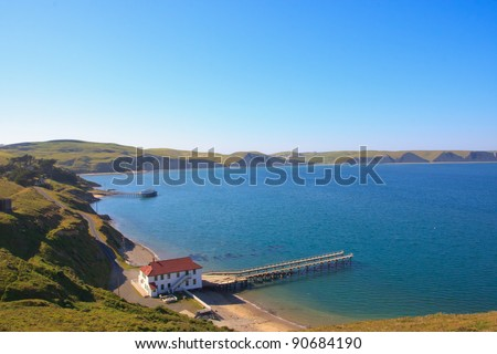Old Building with a pier by the water, Drakes Bay, Point Reyes NS, California - stock photo