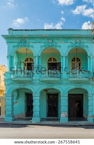 Old building with balconies in Havana - stock photo