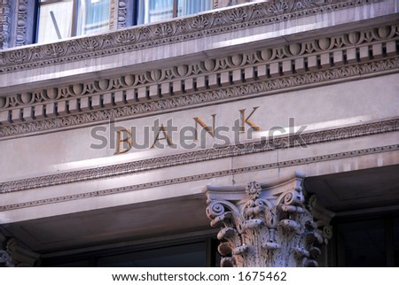 Old building with letters bank on it - stock photo