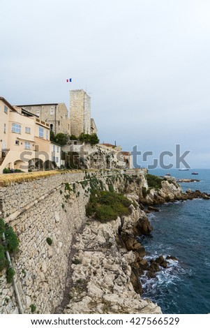 Old buildings and fortified walls of Antibes near the Mediterranean sea, French Riviera, France - stock photo