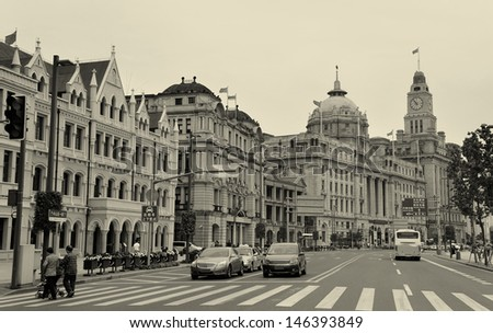 Old buildings and street view in Waitan of Shanghai in black and white - stock photo