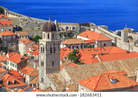Old buildings and the Franciscan Monastery tower near the Adriatic sea, Dubrovnik, Croatia - stock photo