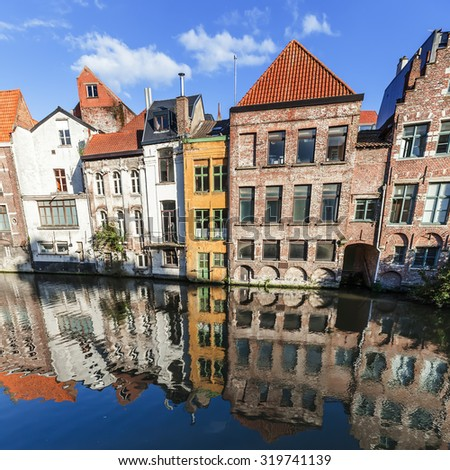 old buildings at a canal in Ghent, Belgium - stock photo