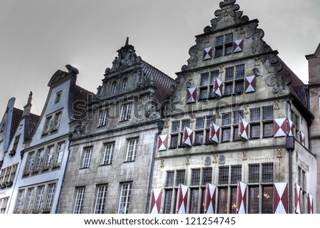 Old buildings at historical street in Muenster, Germany - stock photo