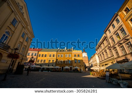 Old buildings at market square on the sunrise in Lublin old city in Poland