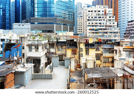 Old buildings coexist with modern skyscrapers in Hong Kong. Hong Kong is popular tourist destination of Asia and leading financial centre of the world. - stock photo