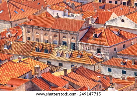 Old buildings covered with orange roof tiles in the old town of Dubrovnik, Croatia - stock photo